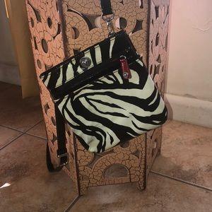 Zebra-print cross body handbag.